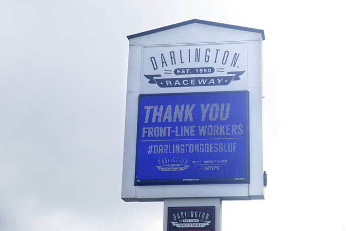 A sign at Darlington Raceway displays a message thanking front-line workers Sunday, May 17, 2020, in Darlington, S.C. NASCAR, which has been idle since March 8 because of the coronavirus pandemic, makes its return with the Real Heroes 400 Nascar Cup Series auto race Sunday. (AP Photo/Brynn Anderson)