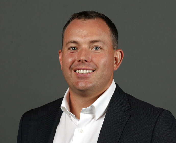 FILE - This is a Sept. 24, 2018, file photo showing Milwaukee Bucks NBA basketball team general manager Jon Horst during media day in Milwaukee. Horst took a break from his busy schedule Monday night, June 24, 2019, to collect the 2018-19 NBA Executive of the Year Award. Horst won the honor during the league's awards show in Santa Monica, California, four days after he and his staff put a bow on the draft and six days before the flood gates open to one of the most anticipated NBA free agency periods in history.(AP Photo/Morry Gash)