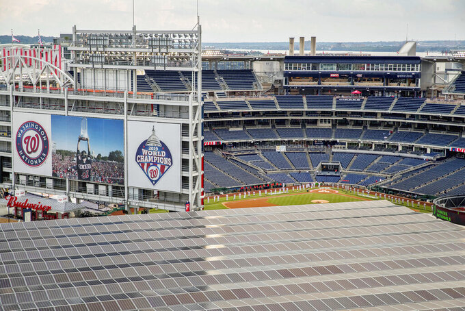The New York Yankees and the Washington Nationals take the field for opening ceremonies before playing an opening day baseball game, Thursday, July 23, 2020, in Washington. (AP Photo/Andrew Harnik)
