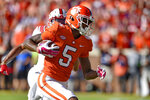 Clemson's Tee Higgins runs in for a touchdown after catching a pass during the first half of an NCAA college football game against North Carolina State, Saturday, Oct. 20, 2018, in Clemson, S.C. (AP Photo/Richard Shiro)