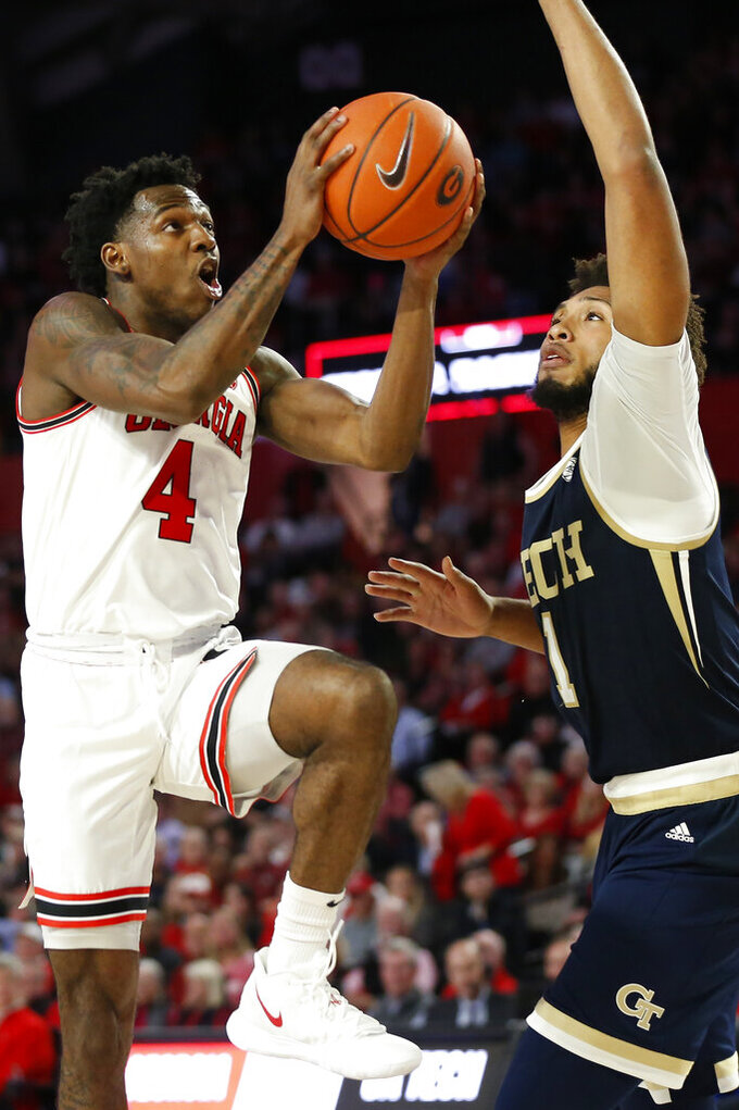 Georgia's Tyree Crump (4) goes to the basket as Georgia Tech forward James Banks III (1) defends during an NCAA college basketball game Wednesday, Nov. 20, 2019, in Athens, Ga. (Joshua L. Jones/Athens Banner-Herald via AP)