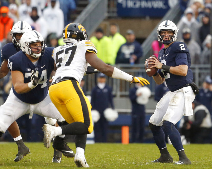 Penn State quarterback Tommy Stevens (2) drops back to pass against Iowa during the first half of an NCAA college football game in State College, Pa., Saturday, Oct. 27, 2018. (AP Photo/Chris Knight)