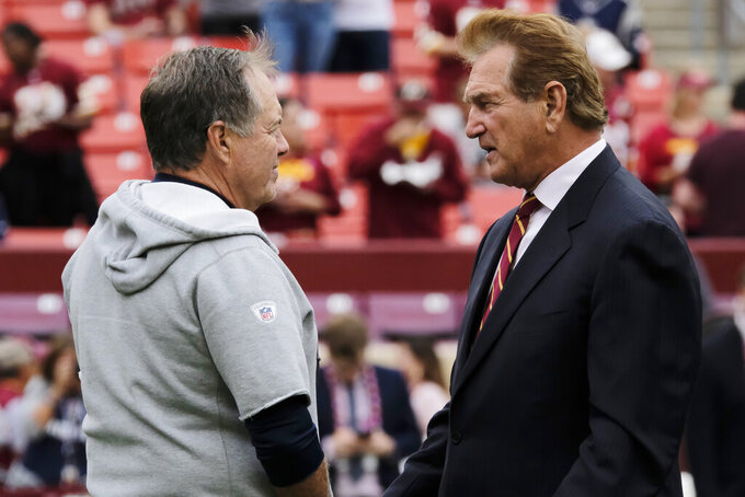 New England Patriots head coach Bill Belichick, left, speaks with former NFL player Joe Theismann ahead of an NFL football game between the Washington Redskins and the New England Patriots, Sunday, Oct. 6, 2019, in Washington. (AP Photo/Mark Tenally)