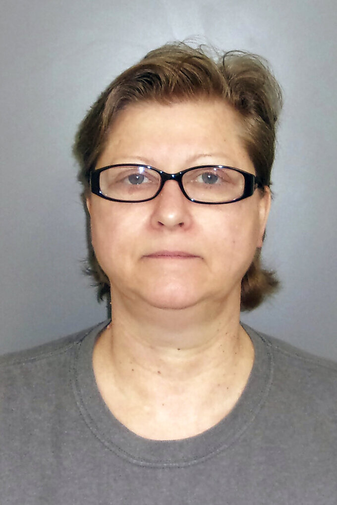 This undated photo provided by the Iowa Department of Public Safety shows Michelle Boat. Boat, an Iowa woman who stabbed her estranged husband's girlfriend to death was found guilty Tuesday, May 11, 2021, of first-degree murder. A Marion County jury deliberated less than an hour before convicting Michelle Boat in the May 18, 2020, death of Tracy Mondabough, 46, who was stabbed as she sat in her truck in Pella, Iowa. (Iowa Department of Public Safety via AP)
