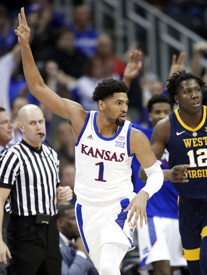 Kansas forward Dedric Lawson (1) celebrates a 3-point basket during the second half of the team's NCAA college basketball game against West Virginia in the semifinals of the Big 12 men's tournament in Kansas City, Mo., Friday, March 15, 2019. Kansas defeated West Virginia 88-74. (AP Photo/Orlin Wagner)