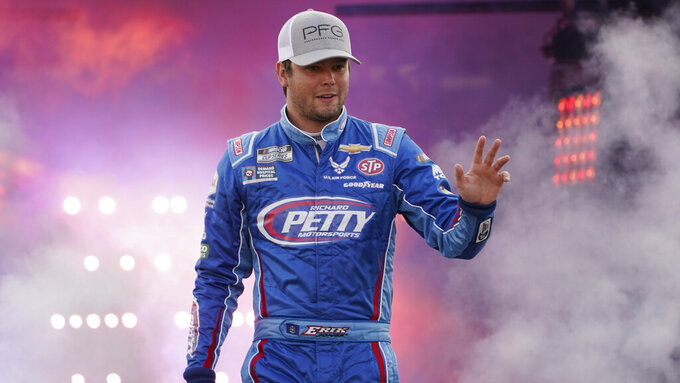 Erik Jones waves to the crowd during driver introductions prior to the start of the NASCAR Cup series auto race in Richmond, Va., Saturday, Sept. 11, 2021. (AP Photo/Steve Helber)