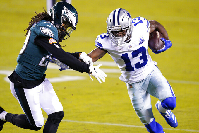 Dallas Cowboys' Michael Gallup (13) tries to get past Philadelphia Eagles' Avonte Maddox (29) during the first half of an NFL football game, Sunday, Nov. 1, 2020, in Philadelphia. (AP Photo/Chris Szagola)