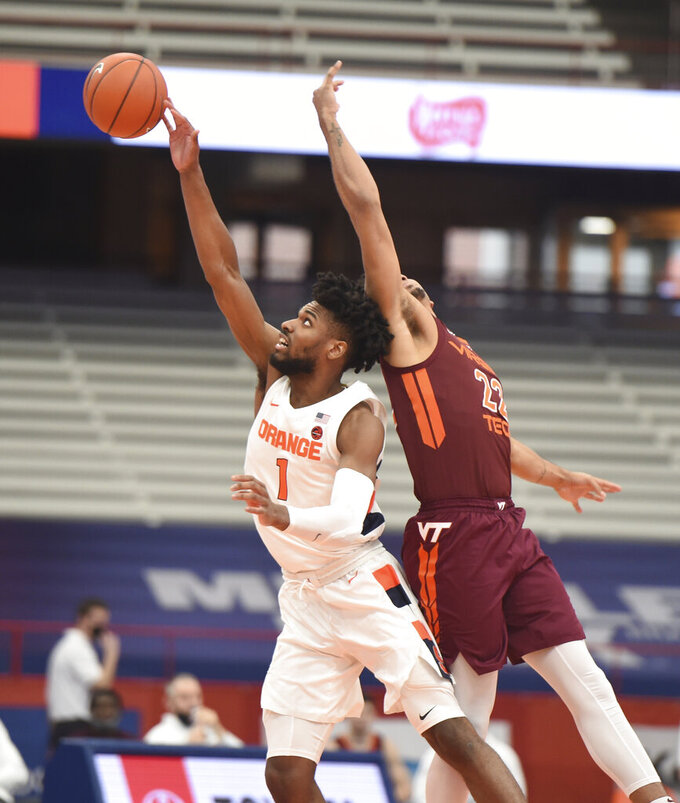 Syracuse Orange forward Quincy Guerrier (1) controls the opening tip against Virginia Tech's Keve Aluma (22)  during an NCAA college basketball game at the Carrier Dome, Syracuse, N.Y., Saturday Jan. 23, 2021. (Scott Schild/The Post-Standard via AP)