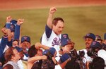 FILE - In this May 1, 1991, file photo, Texas Rangers pitcher Nolan Ryan is carried off the field by his teammates after throwing his seventh no-hitter, against the the Toronto Blue Jays in Arlington, Texas. Ryan was selected in the 12th round of the 1965 baseball draft. (AP Photo/Bill Janscha, File)