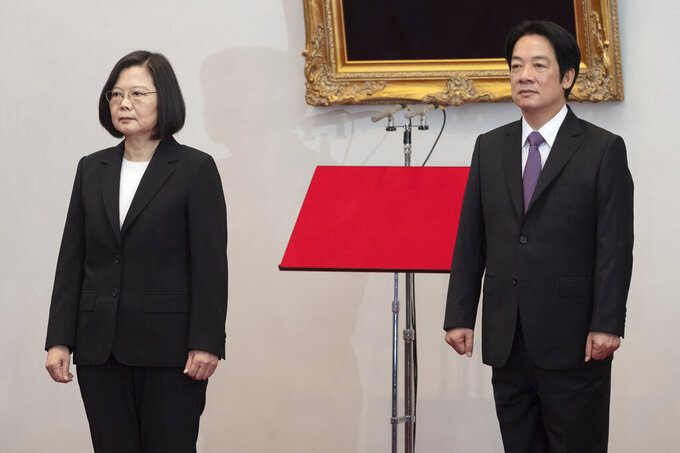 In this photo released by the Taiwan Presidential Office, Taiwanese President Tsai Ing-wen, left stands with Vice President Lai Ching-te during an inauguration ceremony at the Presidential office in Taipei, Taiwan on Wednesday, May 20, 2020. Tsai has been inaugurated for a second term amid increasing pressure from China on the self-governing island democracy it claims as its own territory. (Taiwan Presidential Office via AP)