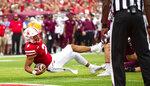 Nebraska quarterback Adrian Martinez (2) scores a touchdown during the first half of an NCAA college football game against Fordham, Saturday, Sept. 4, 2021, at Memorial Stadium in Lincoln, Neb. (AP Photo/Rebecca S. Gratz)