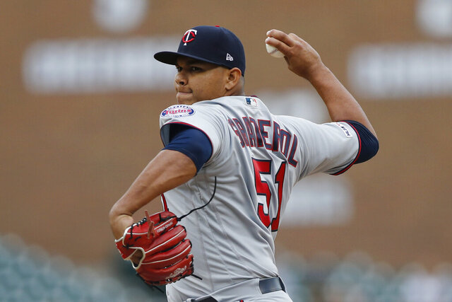 FILE - In this Sunday, Sept. 1, 2019 file photo, Minnesota Twins relief pitcher Brusdar Graterol throws his first MLB pitch during the ninth inning of a baseball game against the Detroit Tigers in Detroit. With less than a week before pitchers and catchers were scheduled to report to spring training, the Red Sox sent Mookie Betts and David Price to the Los Angeles Dodgers in a deal that brought outfielder Alex Verdugo and Twins pitching prospect Brusdar Graterol to Boston. (AP Photo/Carlos Osorio, File)