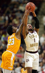 Texas A&M guard Savion Flagg (1) gets control of a midcourt high pass from Tennessee guard Jordan Bowden (23) during the first half of an NCAA college basketball game Saturday, Feb. 2, 2019, in College Station, Texas. (AP Photo/Michael Wyke)