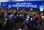 FILE - In this Dec. 1, 2013, file photo, fans enter the Rogers Centre before the Buffalo Bills played the Atlanta Falcons in an NFL football game in Toronto. The NFL has played six games in Toronto and three in Mexico City. (Mark Blinch/The Canadian Press via AP)