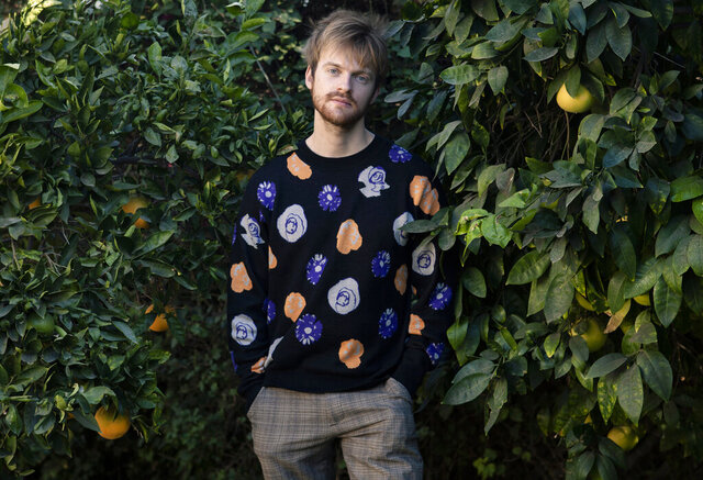 Finneas O'Connell poses at his home in Los Angeles on Friday Dec. 4 2020. O'Connell has been named one of The Associated Press' Breakthrough Entertainers of 2020. (Photo by Rebecca Cabage/Invision/AP)