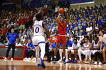 Dayton guard Ibi Watson (2) shoots over Kansas guard Marcus Garrett (0) during the first half of an NCAA college basketball game Wednesday, Nov. 27, 2019, in Lahaina, Hawaii. (AP Photo/Marco Garcia)