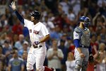 Boston Red Sox's Xander Bogaerts, left, celebrates his solo home run as Los Angeles Dodgers' Russell Martin looks away during the eighth inning of a baseball game in Boston, Sunday, July 14, 2019. (AP Photo/Michael Dwyer)