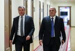 In this photo provided by The State Duma, The Federal Assembly of The Russian Federation, Russian State Duma speaker Vyacheslav Volodin, left, and Russian Tax Service chief Mikhail Mishustin, who was nominated to replace Medvedev, walk in the State Duma, the Lower House of the Russian Parliament in Moscow, Russia, Thursday, Jan. 16, 2020. Russian President Vladimir Putin has named tax service chief Mikhail Mishustin as Russia's new prime minister. (The State Duma, The Federal Assembly of The Russian Federation via AP)