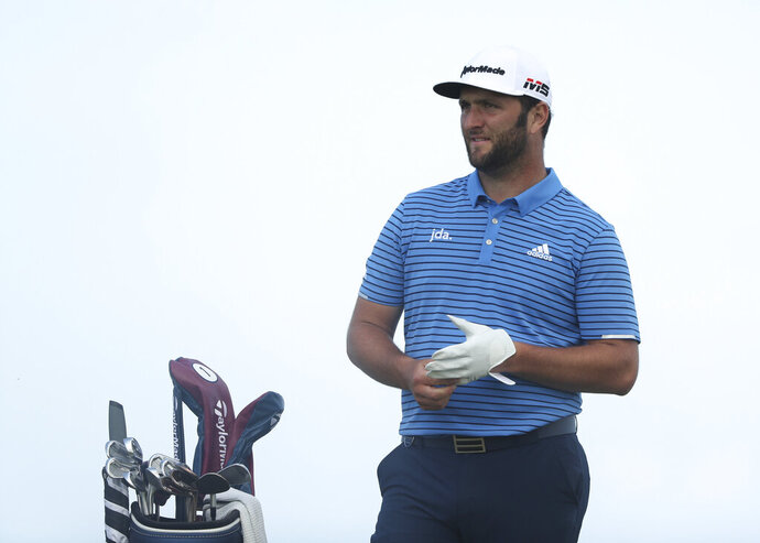 Spain's Jon Rahm waits to play off the 6th tee during a practice round ahead of the start of the British Open golf championships at Royal Portrush in Northern Ireland, Tuesday, July 16, 2019. The British Open starts Thursday. (AP Photo/Jon Super)