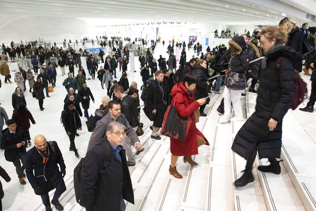 FILE - In this Dec. 4, 2019, file photo commuters pass through the World Trade Center in New York. A study by a U.S. agency has found that facial recognition technology often performs unevenly based on a person's race, gender or age. This is the first time the National Institute of Standards and Technology has investigated demographic differences in how face-scanning algorithms are able to identify people. (AP Photo/Mark Lennihan, File)