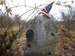 This Dec. 10, 2019, photo shows the gravestone of Revolutionary War soldier William Haven who is buried in a cemetery in Weybridge, Vt., near the edge of an eroding river bank. Rising seas, erosion and flooding from worsening storms that some scientists believe are caused by climate change are putting some older graveyards across the country at risk. (AP Photo/Lisa Rathke)