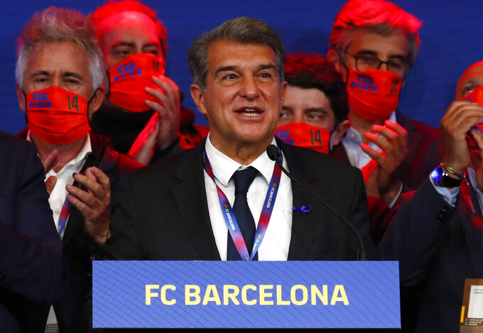 FILE - In this Sunday, March 7, 2021 file photo, Joan Laporta celebrates his victory after elections at the Camp Nou stadium in Barcelona, Spain. Barcelona president Joan Laporta maintained his support for the Super League on Thursday April 22, 2021, despite the quick exit of 10 of the 12 founding clubs in the breakaway competition. (AP Photo/Joan Monfort, File)