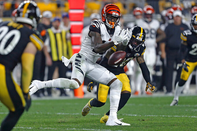 Cincinnati Bengals wide receiver Auden Tate (19) cannot hang onto a pass from quarterback Andy Dalton with Pittsburgh Steelers cornerback Cameron Sutton (20) defending during the second half of an NFL football game in Pittsburgh, Monday, Sept. 30, 2019. (AP Photo/Tom Puskar)