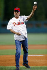 Actor Bruce Willis throws out a first pitch before a baseball game between the Philadelphia Phillies and the Milwaukee Brewers, Wednesday, May 15, 2019, in Philadelphia. (AP Photo/Matt Slocum)