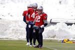 New England Patriots quarterback Tom Brady (12) warms up with quarterbacks Cody Kessler, behind left, and Jarrett Stidham (4) during an NFL football practice, Wednesday, Dec. 4, 2019, in Foxborough, Mass. (AP Photo/Steven Senne)