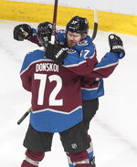 Colorado Avalanche's Joonas Donskoi (72) and J.T. Compher (37) celebrate a goal against the Arizona Coyotes during the third period of a first-round NHL Stanley Cup playoff hockey game in Edmonton, on Wednesday, Aug. 12, 2020. (Jason Franson/The Canadian Press via AP)