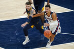 West Virginia's Jordan McCabe (5) and Gonzaga's Jalen Suggs (1) eye a loose during the first half of an NCAA college basketball game Wednesday, Dec. 2, 2020, in Indianapolis. (AP Photo/Darron Cummings)