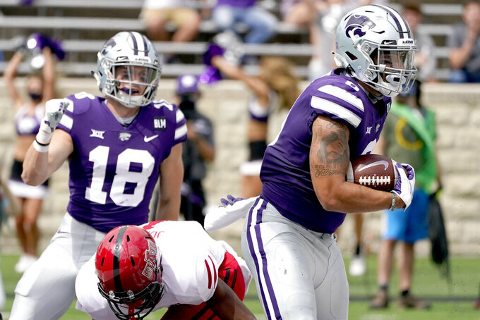 Kansas State tight end Briley Moore, right, catches a pass in the end zone to score a touchdown during the first half of an NCAA college football game against Arkansas State Saturday, Sept. 12, 2020, in Manhattan, Kan. (AP Photo/Charlie Riedel)