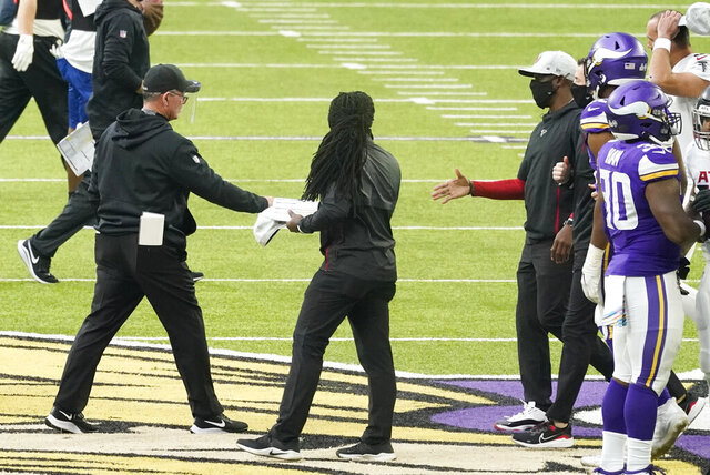 Minnesota Vikings head coach Mike Zimmer, left, greets Atlanta Falcons head coach Raheem Morris, right, after an NFL football game, Sunday, Oct. 18, 2020, in Minneapolis. The Falcons won 40-23. (AP Photo/Jim Mone)