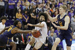 Washington guard Marcus Tsohonis, center, drives between California guard Kareem South, left, and forward Lars Thiemann during the second half of an NCAA college basketball game Saturday, Feb. 22, 2020, in Seattle. Washington won 87-52. (AP Photo/Ted S. Warren)