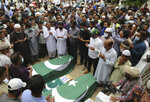 Mourners attend a funeral for some of the people who died in the crash of a state-run Pakistan International Airlines plane May 22, in Karachi, Pakistan, Tuesday, June 2, 2020. (AP Photo/Fareed Khan)
