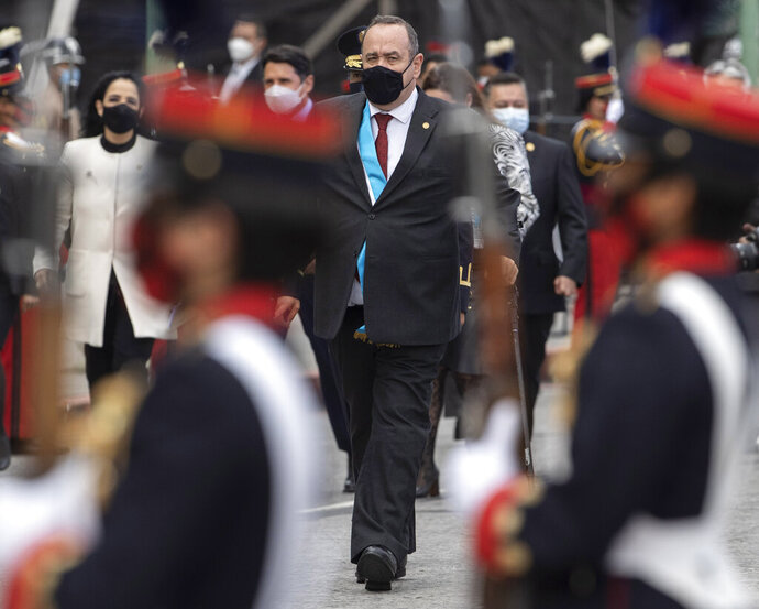 Guatemalan President Alejandro Giammattei wearing a protective face mask as a precaution against the new coronavirus arrives at Constitution square for the independence day celebration in Guatemala City, Monday, Sept. 14, 2020. Guatemala and Central America are celebrating 199 years of independence from Spain. (AP Photo/Moises Castillo)