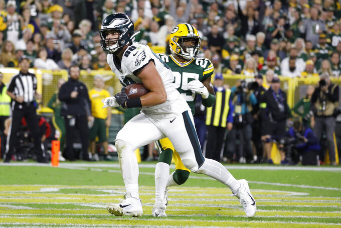 Philadelphia Eagles tight end Dallas Goedert catches a pass for a touchdown while being covered by Green Bay Packers cornerback Will Redmond during the first half of an NFL football game Thursday, Sept. 26, 2019, in Green Bay, Wis. (AP Photo/Jeffrey Phelps)