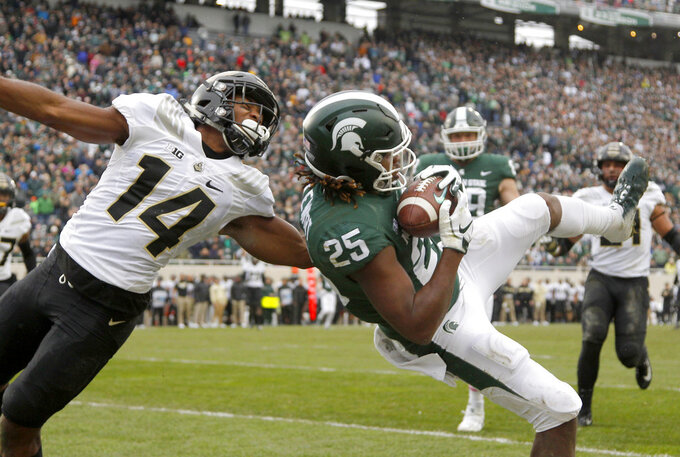 Michigan State receiver Darrell Stewart (25) pulls in a pass in the end zone but comes down with a foot out of bounds against Purdue cornerback Antonio Blackmon (14) during the second quarter of an NCAA college football game, Saturday, Oct. 27, 2018, in East Lansing, Mich. (AP Photo/Al Goldis)