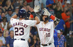 Houston Astros' Yuli Gurriel is greeted by teammate Michael Brantley after his two-run home run against the Texas Rangers in the fifth inning of a baseball game Saturday, July 20, 2019, in Houston. (AP Photo/Richard Carson)