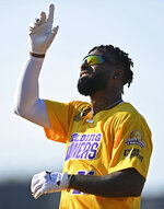 Cleveland Browns wide receiver Jarvis Landry celebrates after a hit during the Jarvis Landry Celebrity Softball game Saturday, June 12, 2021, in Eastlake, Ohio. (AP Photo/David Dermer)