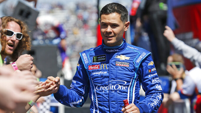 NASCAR Cup Series driver Kyle Larson (42) greets fans during driver introductions prior to the NASCAR Cup Series auto race at the Martinsville Speedway in Martinsville, Va., Sunday, March 24, 2019. (AP Photo/Steve Helber)