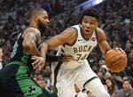 Milwaukee Bucks' Giannis Antetokounmpo tries to drive past Boston Celtics' Marcus Morris during the first half of Game 1 of a second round NBA basketball playoff series Sunday, April 28, 2019, in Milwaukee. (AP Photo/Morry Gash)