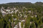 In this March 14, 2019, photo, downtown Nevada City is surrounded by a dense forested area, which increases its fire risk. City officials agree that the wooded draws, steep hillsides, narrow residential streets, ancient homes and thick urban tree canopy that define the character of the city also make it particularly at risk if a fire burns through. (Hector Amezcua/The Sacramento Bee via AP)