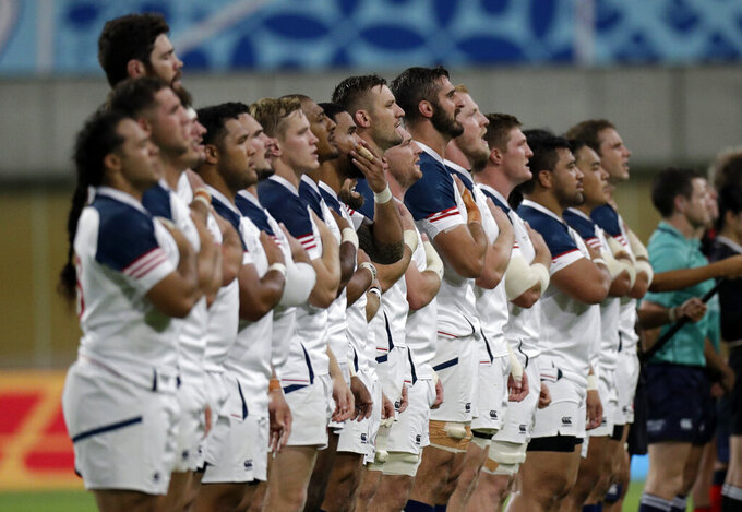 FILE - In this Thursday, Sept. 26, 2019 file photo, the US team sing their national anthem ahead of the Rugby World Cup Pool C game at Kobe Misaki Stadium, between England and the United States in Kobe, Japan. Being forced to file for bankruptcy during the coronavirus outbreak has not stopped American rugby leaders from retaining their long-held ambition of hosting an upcoming World Cup. A Rugby World Cup in 2027 would slot right between the soccer World Cup lined up for 2026 in the U.S, Canada and Mexico and the Los Angeles Olympics two years later. (AP Photo/Aaron Favila, File)