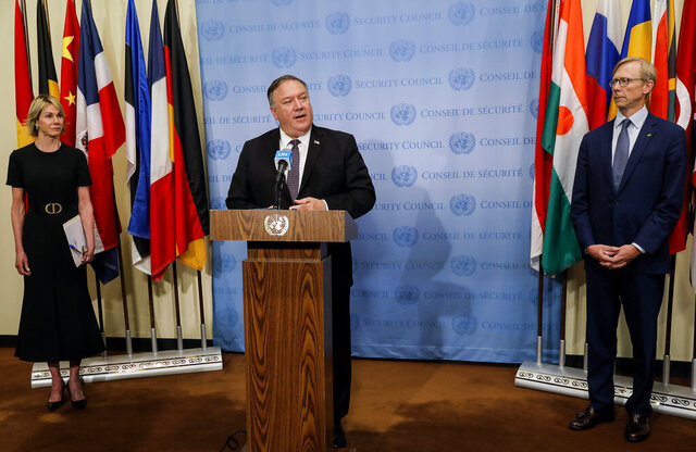 Secretary of State Mike Pompeo speaks to reporters following a meeting with members of the U.N. Security Council, Thursday, Aug. 20, 2020, at the United Nations, as U.S. Ambassador to the United Nations Kelly Craft and U.S. special representative for Iran Brian Hook listen.  The Trump administration has formally notified the United Nations of its demand for all U.N. sanctions on Iran to be restored, citing significant Iranian violations of the 2015 nuclear deal.  (Mike Segar/Pool via AP)