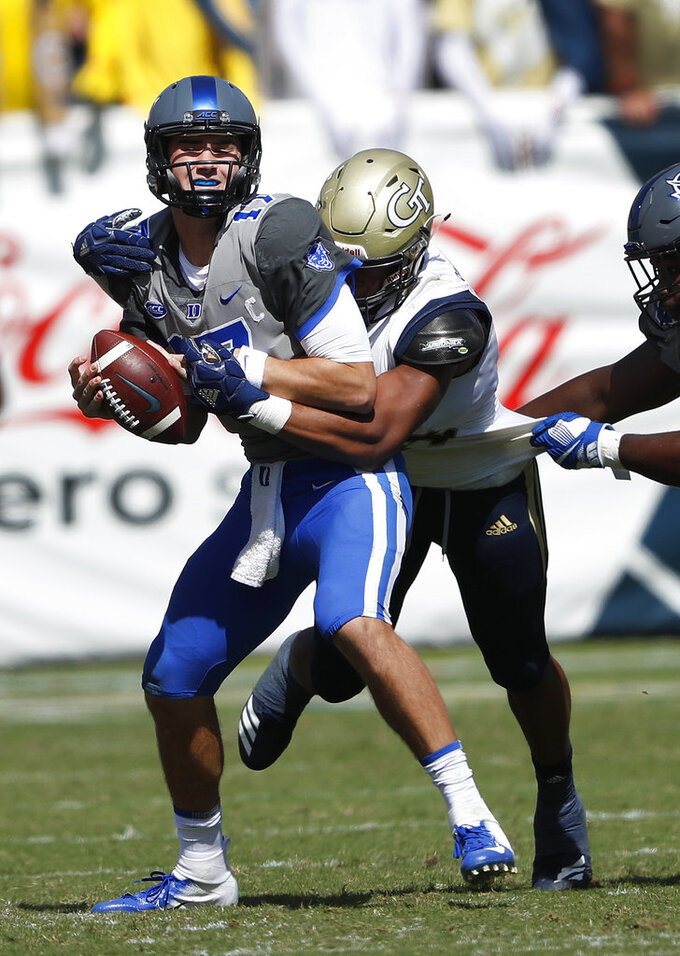 Duke quarterback Daniel Jones (17) is sacked by Georgia Tech defensive lineman Anree Saint-Amour (94) during the first half of the an NCAA college football game, Saturday, Oct. 13, 2018, in Atlanta. (AP Photo/John Bazemore)