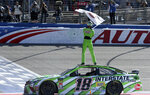 Kyle Busch celebrates after winning the NASCAR Cup Series auto race at Auto Club Speedway in Fontana, Calif., Sunday, March 17, 2019. (James Quigg/The Daily Press via AP)