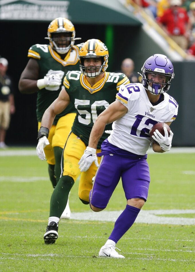 Minnesota Vikings' Chad Beebe breaks away from Green Bay Packers' Blake Martinez for a long gain during the first half of an NFL football game Sunday, Sept. 15, 2019, in Green Bay, Wis. (AP Photo/Mike Roemer)