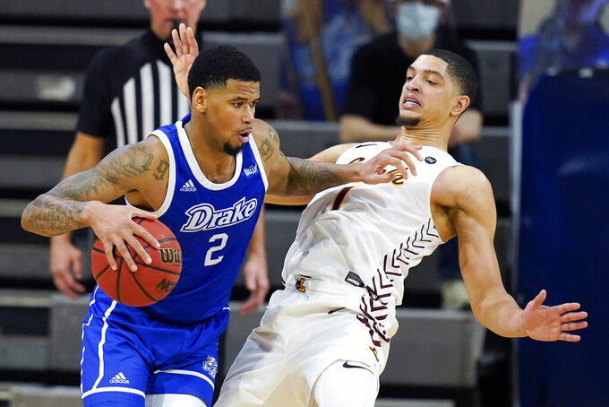 Drake forward Tremell Murphy drives past Loyola of Chicago guard Lucas Williamson, right, during overtime in an NCAA college basketball game, Sunday, Feb. 14, 2021, in Des Moines, Iowa. Drake won 51-50 in overtime. (AP Photo/Charlie Neibergall)