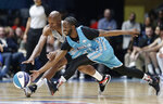 Home team's Famous Los, right, and Away team's Ray Allen chase the ball during the first half of an NBA All-Star Celebrity basketball game in Charlotte, N.C., Friday, Feb. 15, 2019. (AP Photo/Gerry Broome)
